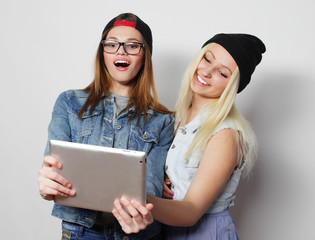 girls taking a self portrait with a tablet