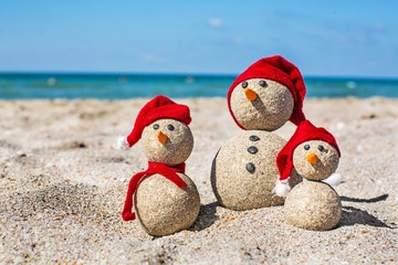 Snowman, beach, summer.
