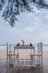 romantic dinner table setup on tropical beach