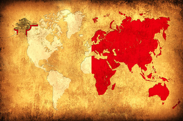 The flag of Malta in the outline of the world map