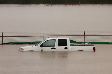 White truck submerged in flood water during the 2013 Calgary flood.