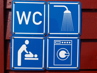 Blue sign of public toilets WC shower washing machines baby