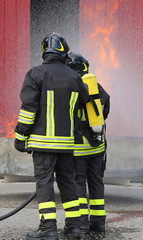 firefighters with oxygen bottles off the fire during a training