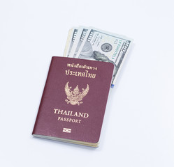 Thai passport book with dollar banknote