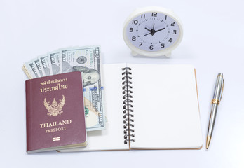 Thai passport book and us dollar with blank notebook