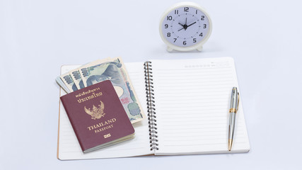 Thai passport book and japanese banknote with blank notebook