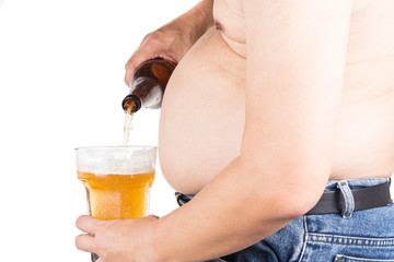 Obese man with big belly pouring a glass of refreshing beer