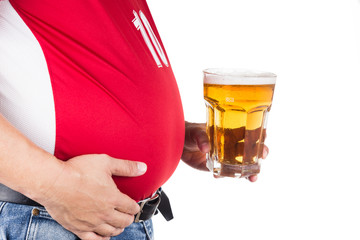 Obese man with big belly holding a glass of cold beer