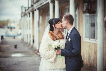 gentle bride and groom embrace