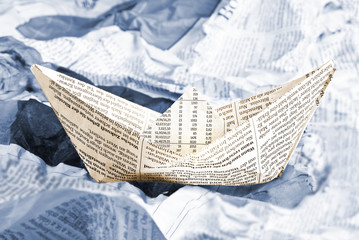 Newspaper boat over newspapers waves