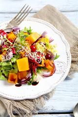 Salad with roasted pumpkin and sesame seeds