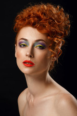 Red-haired. Beautiful girl with bright makeup