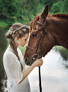 Woman touching horse face