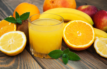 Glass with juice and fresh fruits
