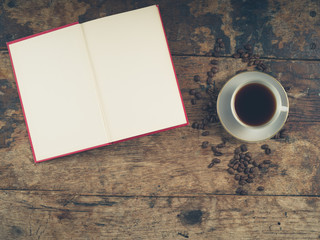 Coffee concept with cup and book