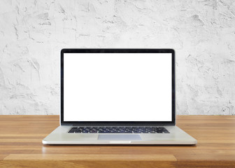 Laptop on table, on  white cement wall background