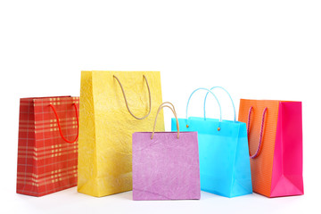 Colorful shopping paper bags isolated on white