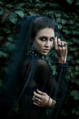 Fashiom model dressed in gothic style. Vamp.