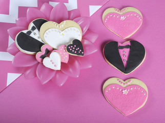 Pink, black and white wedding hearts shape cookies