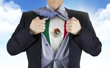 businessman showing Mexico flag underneath his shirt