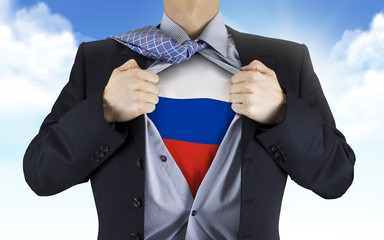 businessman showing Russia flag underneath his shirt