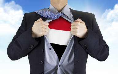 businessman showing Yemen flag underneath his shirt