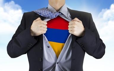 businessman showing Armenia flag underneath his shirt