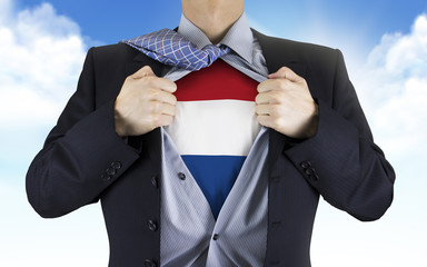businessman showing Dutch flag underneath his shirt