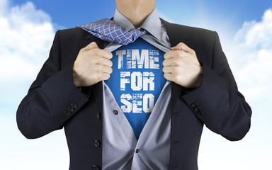 businessman showing Time for SEO words underneath his shirt