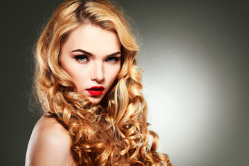 young woman with beautiful blue eyes and red lips