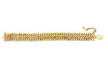 Gold bracelet over white background