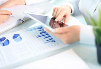 Business adviser analyzing financial figures denoting the progress