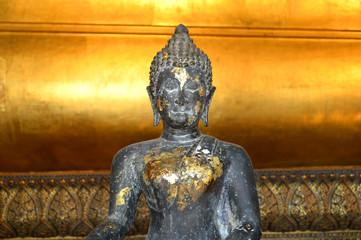 Seated buddha image in the attitude of subduing Mara at Wat Pho, Thailand