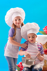 Children cook in a pan