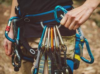Foto op Aluminium Alpinisme Female rock climber wearing safety harness