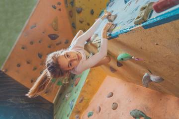 Happy little girl climbing indoor