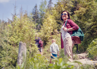 Active family walk in mountain forest