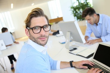 Businessman with eyeglasses working in office