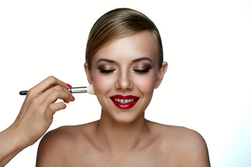 Makeup Artist applying Powder Foundation with Brush.