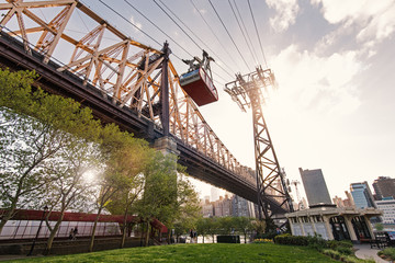 Roosevelt Island Tramway and Queensboro bridge at sunset. The RI
