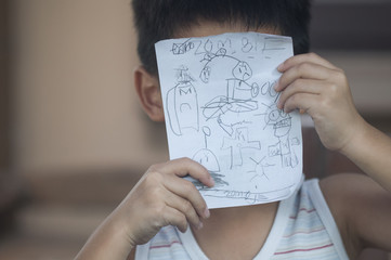 A kid showing his picture plants vs zombies