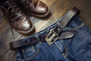 Jeans belt and shoes set on wood