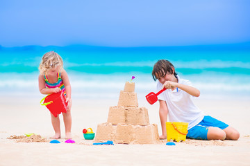 Kids building sand castle on a beach