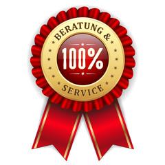 Gold 100 Prozent Beratung und Service Siegel mit roter Scherpe