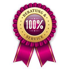 Gold 100 Prozent Beratung und Service Siegel mit lila Scherpe