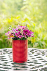 beautiful fake flowers in tin vase the decoration on table at outdoor garden