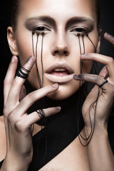 Beautiful girl with creative make-up in Gothic style and the
