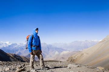 Hiker in high Himalaya mountains