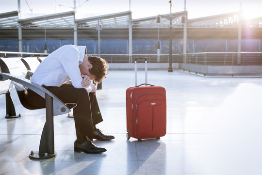 Businessman in working on laptop in airport waiting lounge