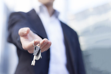 Real estate agent with keys in hand